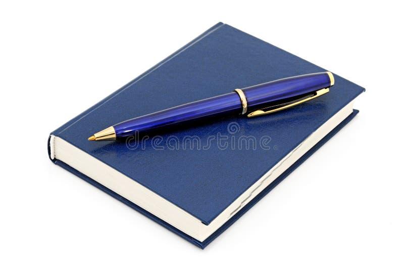 Stylo bille de cahier et photos libres de droits