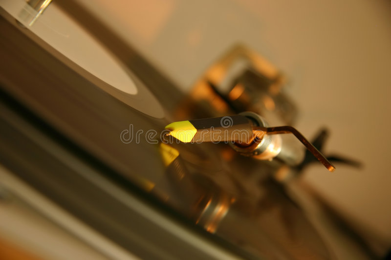Stylus and cartridge on a silver DJ turntable royalty free stock photo