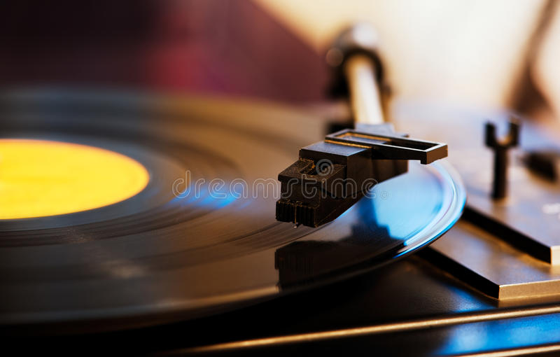 Stylus on a vinyl LP record. Close up photo of a stylus on a vinyl LP record stock photo