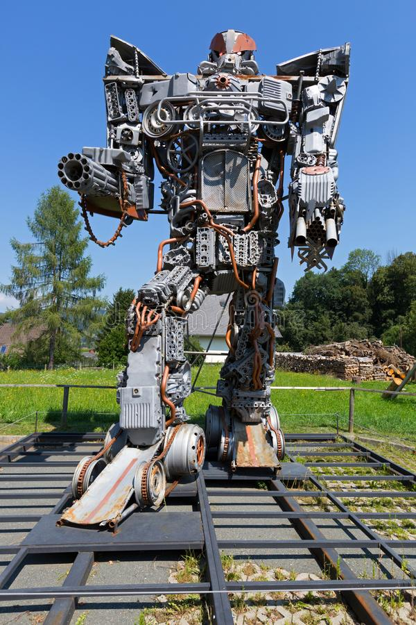 Big tall Transformer art at Arnold Alois Schwarzenegger Museum Thal, Styria in Austria. STYRIA, AUSTRIA - JULY 2018 : Big tall Transformer art at Arnold Alois royalty free stock photography