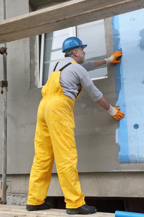 Styrofoam fasadowa izolacja, instaluje siatkę obrazy stock