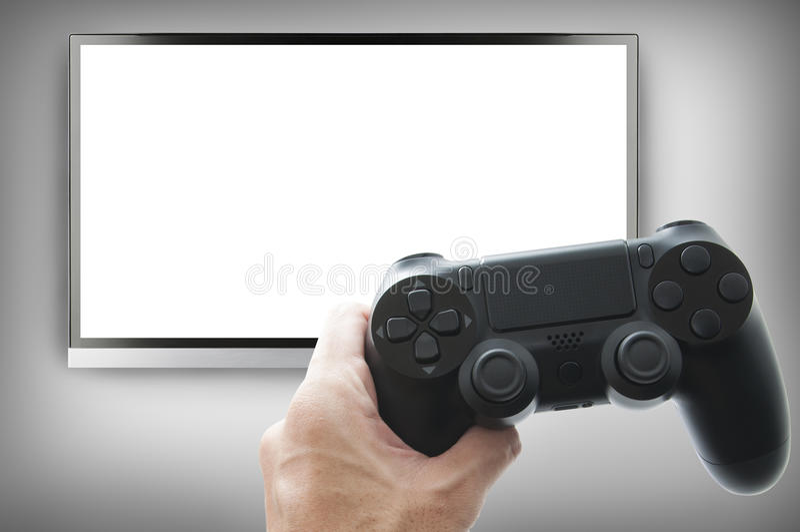 Styrspak för videospelkonsoler i händerna royaltyfria bilder