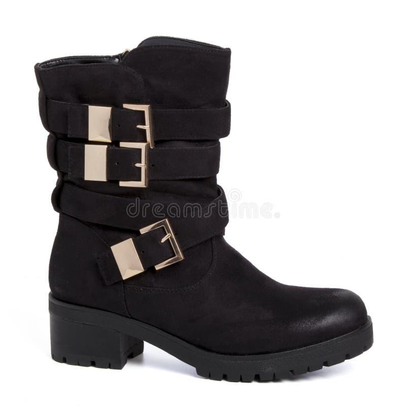 Suède noir de chaussure de botte avec des buskles d'or d'isolement sur le blanc photos libres de droits