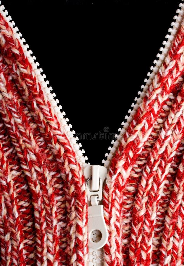Suéter rojo de las lanas con la cremallera abierta fotos de archivo libres de regalías