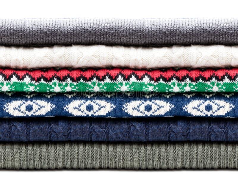 Suéteres doblados de los géneros de punto aislados en blanco Modelo inconsútil horizontal imagen de archivo