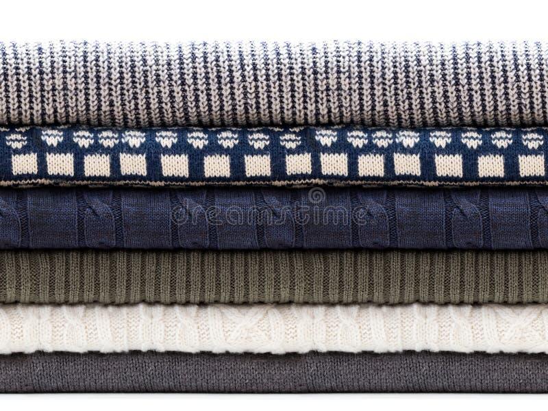 Suéteres doblados de los géneros de punto aislados en blanco Modelo inconsútil horizontal imagenes de archivo