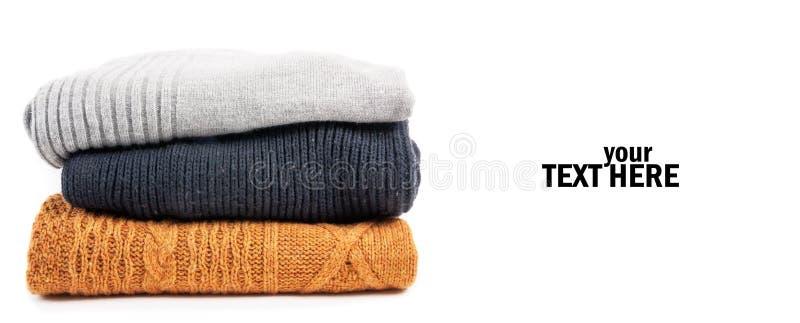 Suéteres en la pila fotografía de archivo libre de regalías
