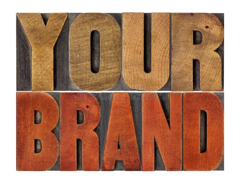 Su extracto de la palabra de la marca en el tipo de madera imagenes de archivo