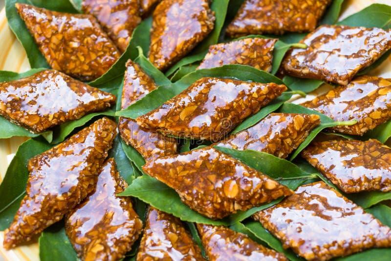 Su Gatou, sardinian dessert. Classic sardinian dessert with caramel and almonds royalty free stock images