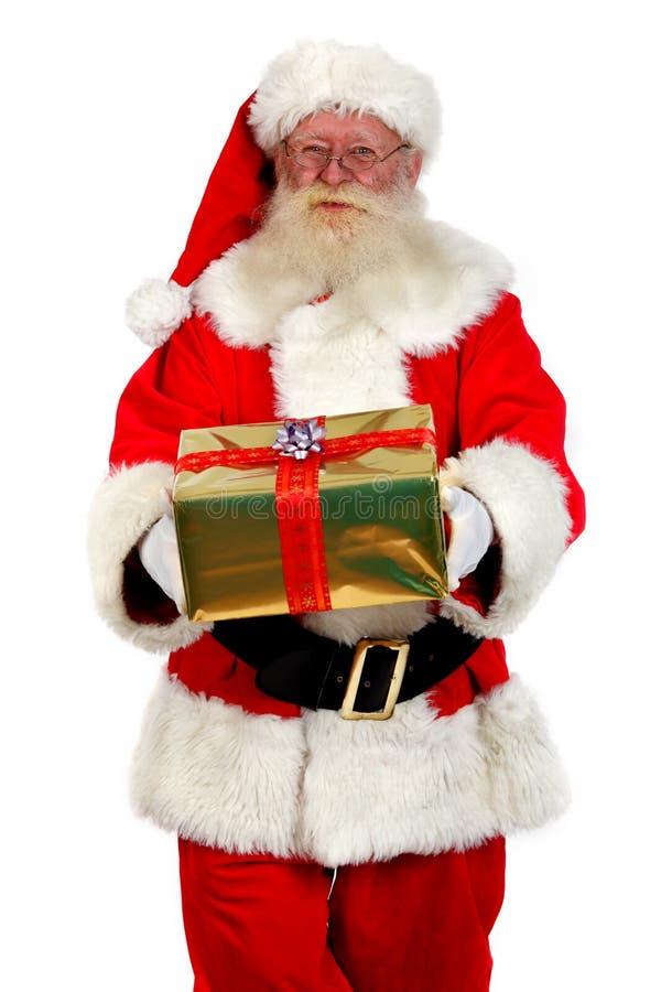 Su regalo de Navidad de santa fotografía de archivo