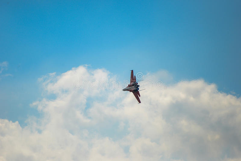 SU-30. Russian newest fighter jet in the blue sky shows higher royalty free stock photography
