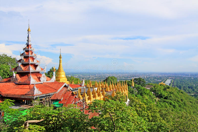 Su Taung Pyai Pagoda And Mandalay Cityscape, Mandalay, Myanmar. The Su Taung Pyai Pagoda is located on the top of the Mandalay Hill. It was built by King stock photos