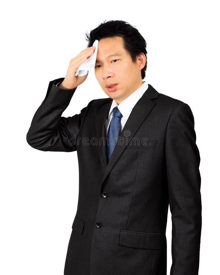 Suando o homem de negócio asiático da Idade Média no branco fotografia de stock royalty free