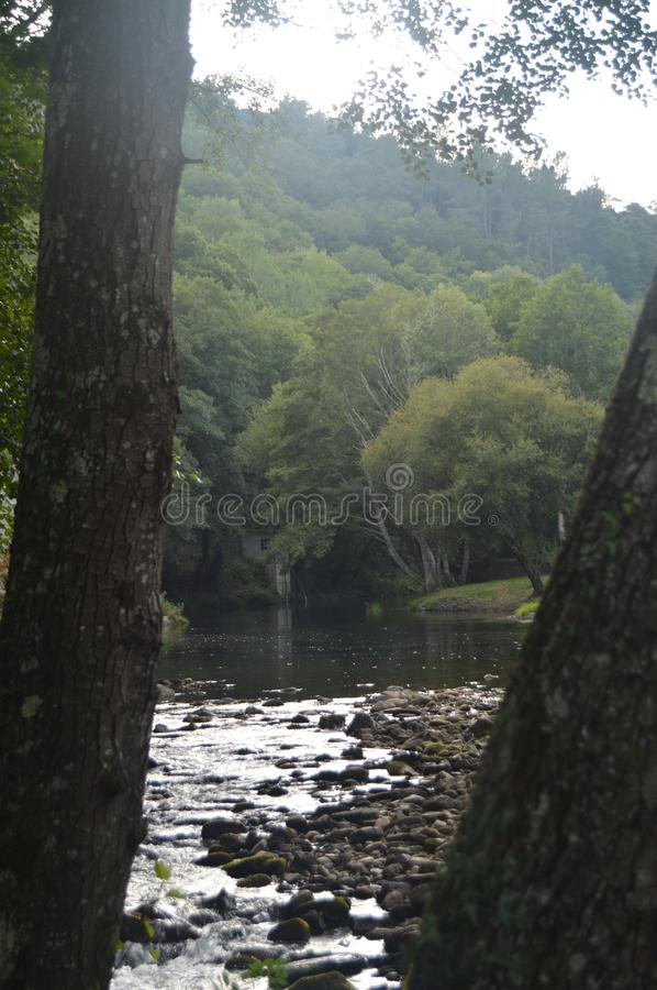 Suarna River On Its Passage Between Two Holm oak In Navia De Suarna. Nature, Architecture, History, Street Photography. August 23 stock photography