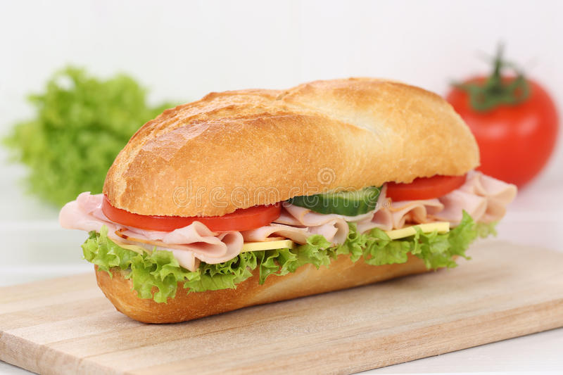 Sub deli sandwich baguette with ham for breakfast. Sub deli sandwich baguette with ham, cheese, tomatoes and lettuce for breakfast royalty free stock photos