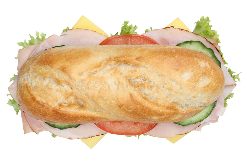 Sub deli sandwich baguette with ham top view isolated. Sub deli sandwich baguette with ham, cheese, tomatoes and lettuce top view isolated on a white background royalty free stock image