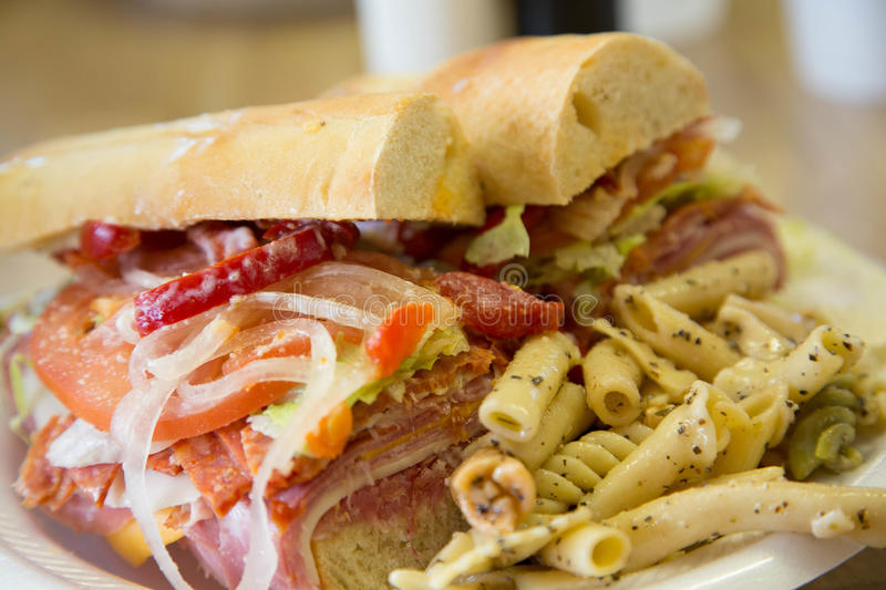 Sub Sandwich on French Bread with Pasta Salad royalty free stock photos