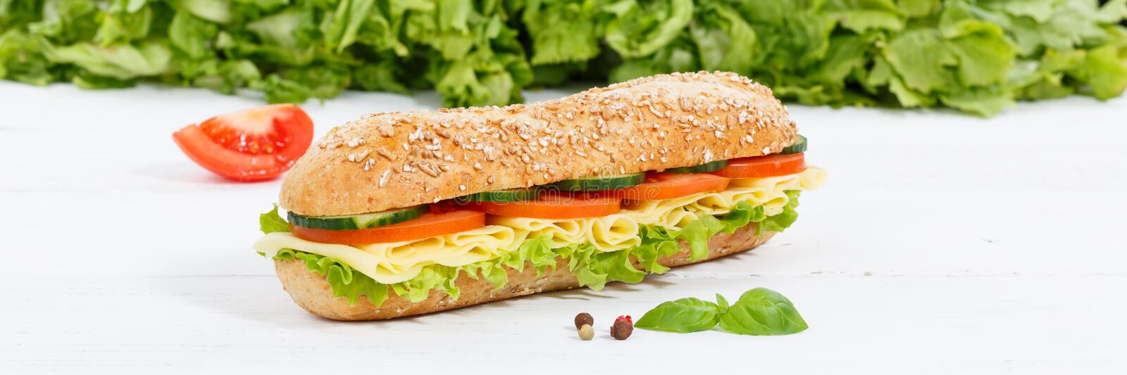 Sub sandwich whole grain grains baguette with cheese banner on w. Ooden board wood stock image
