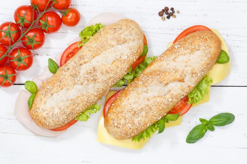 Sub sandwich whole grain grains baguette with cheese and ham fro. M above on wooden board wood royalty free stock photo