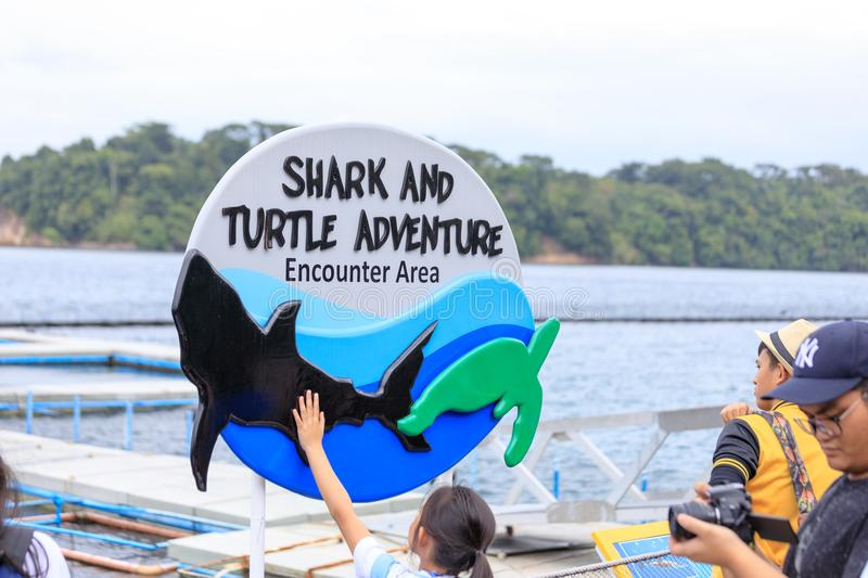 Sign of Shark and Turtle adventure encounter area in Subic Ocean stock photo