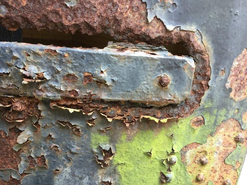 Rusted metal plate  and paint closeup. stock photos