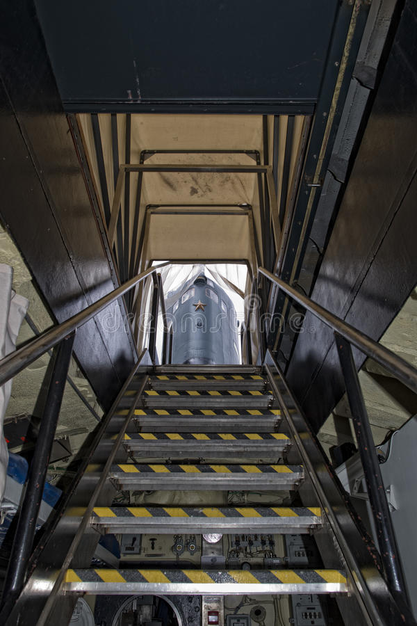 Submarine exit ladder to exterior tower stock photography