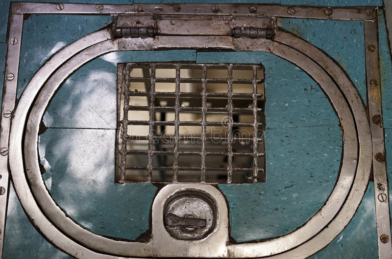 Submarine floor hatch and grate. Metal grate in floor hatch of USS Razorback, a World War II diesel submarine, allows personnel to see cargo below decks. It also royalty free stock photography