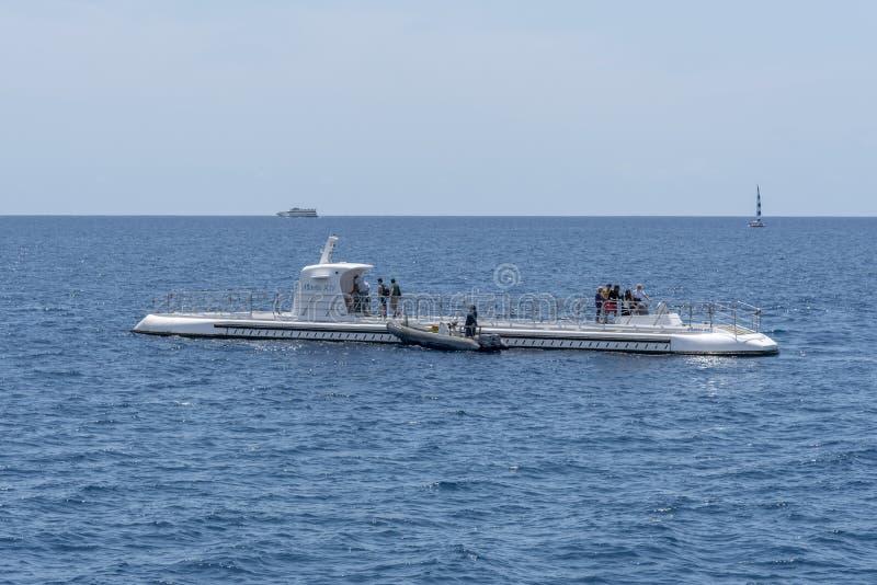 Submarine operated by Atlantis Waikiki Submarine Adventure. Honolulu, Hawaii - March 30, 2019: Submarine operated by Atlantis Waikiki Submarine Adventure. The stock photos