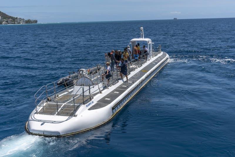 Submarine operated by Atlantis Waikiki Submarine Adventure. Honolulu, Hawaii - March 30, 2019: Submarine operated by Atlantis Waikiki Submarine Adventure. The stock photo