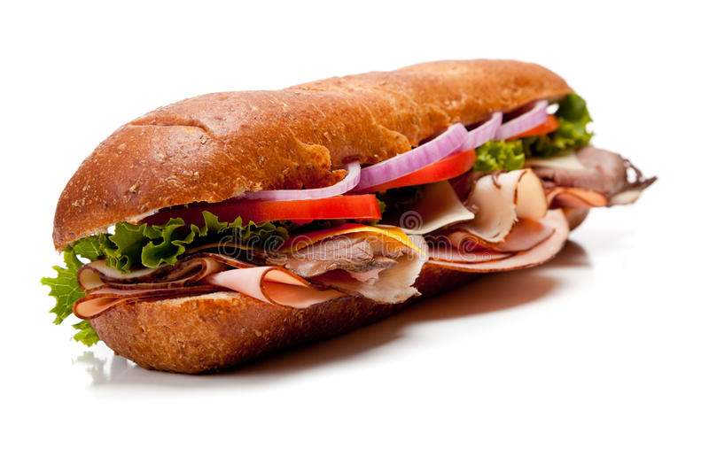 A submarine sandwich on a white background royalty free stock images
