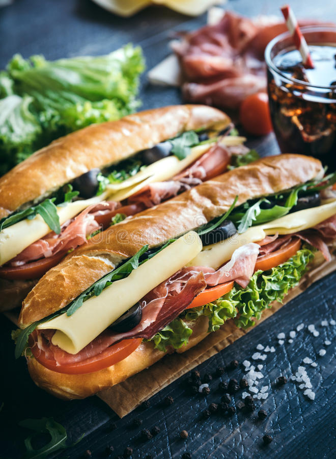 Submarine sandwiches served. On the table,selective focus stock photography