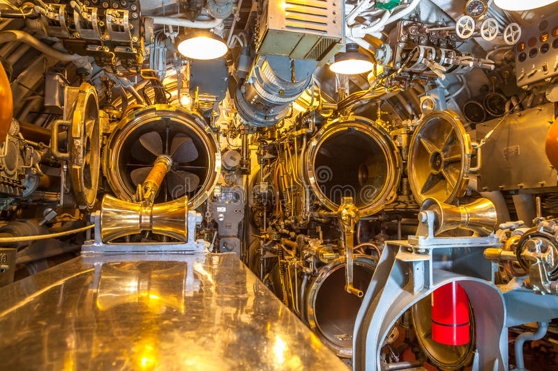 Submarine torpedo room. HONOLULU, OAHU, HAWAII, USA - AUGUST 21, 2016: torpedo room with torpedoes and camp beds for the crew of USS Bowfin Submarine SS-287 at stock photo