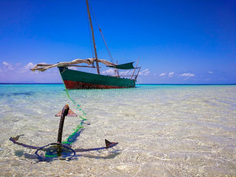 The Submerged Beach. Wooden boat anchored submerged beach Tanzania stock photography