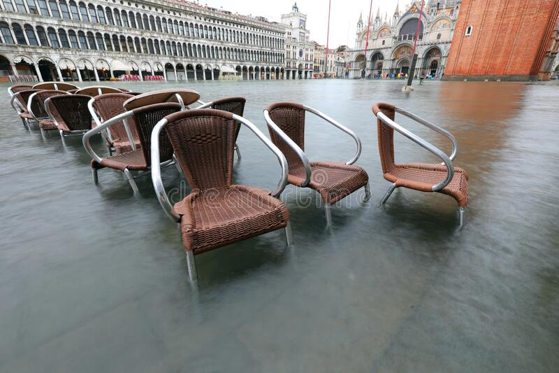 Submerged chairs in Saint Mark Square in Venice Italy. During the flood stock photos