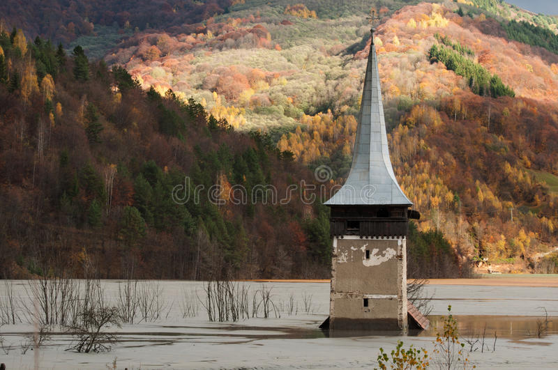 Submerged church at geamana. The church's dome seen in a former village from Romania, submerged in the polluted residuals from a copper mine stock image