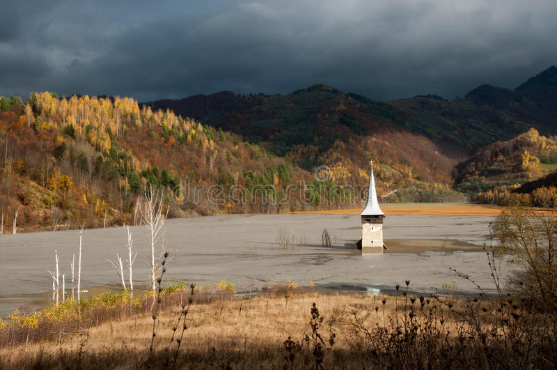 Submerged church at geamana. The church's dome seen in a former village from Romania, submerged in the polluted residuals from a copper mine royalty free stock images