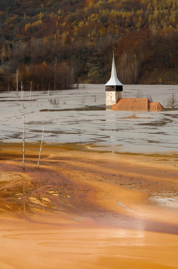 Submerged church at geamana. The church's dome seen in a former village from Romania, submerged in the polluted residuals from a copper mine stock photography
