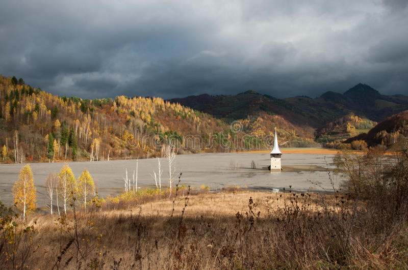 Submerged church at geamana. The church's dome seen in a former village from Romania, submerged in the polluted residuals from a copper mine royalty free stock photography
