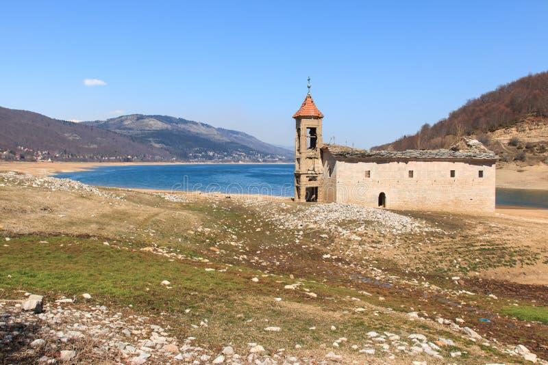 Submerged Church of Mavrovo Lake, Macedonia.  stock photo