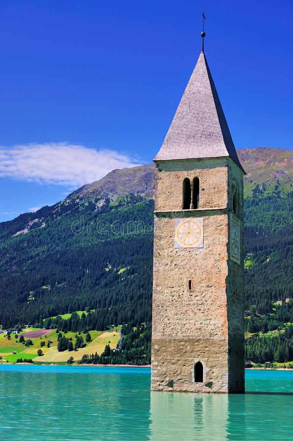 Submerged Church Tower,Reschensee, Italy. The submerged Church tower in the Reschensee, a lake in South Tyrol also known by the Italian name Lago di Resia. The royalty free stock image