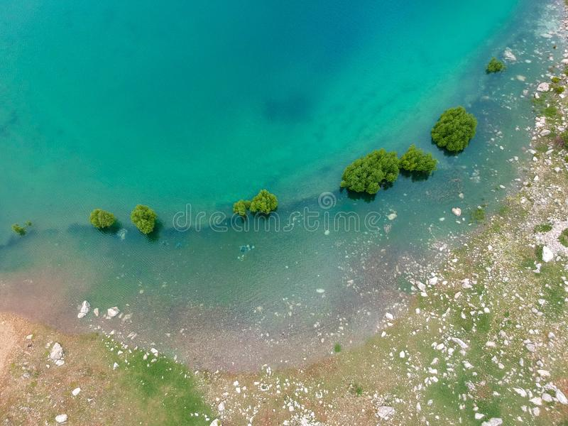 Submerged trees at Green Lake. Ariel view on a lakes shore with trees submerged in the turquoise water. Green lake, Turkey royalty free stock photography