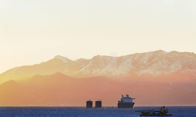Submerging Cargo Ship Royalty Free Stock Photography