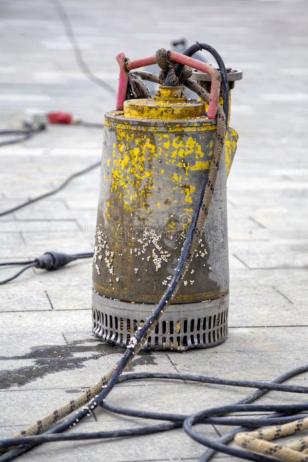 Submersible water pump. Abstract: Sewer Lines Cleaning Service, Unblock a drain, Cleaning blocked sewer, pumping flood water stock photo