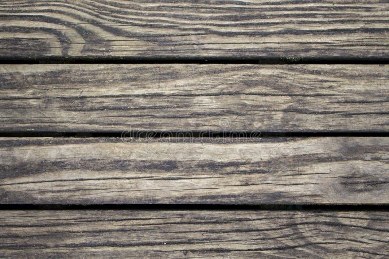 Subtiele houten plankenclose-up Ruwe timmerhoutoppervlakte Warme bruine houten achtergrond voor uitstekende kaart royalty-vrije stock foto's