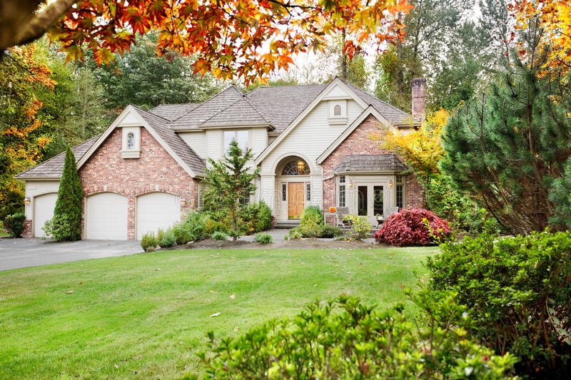 Suburban home in fall stock images