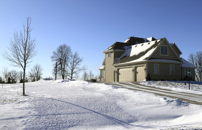 Suburban Home In Snow Stock Photography