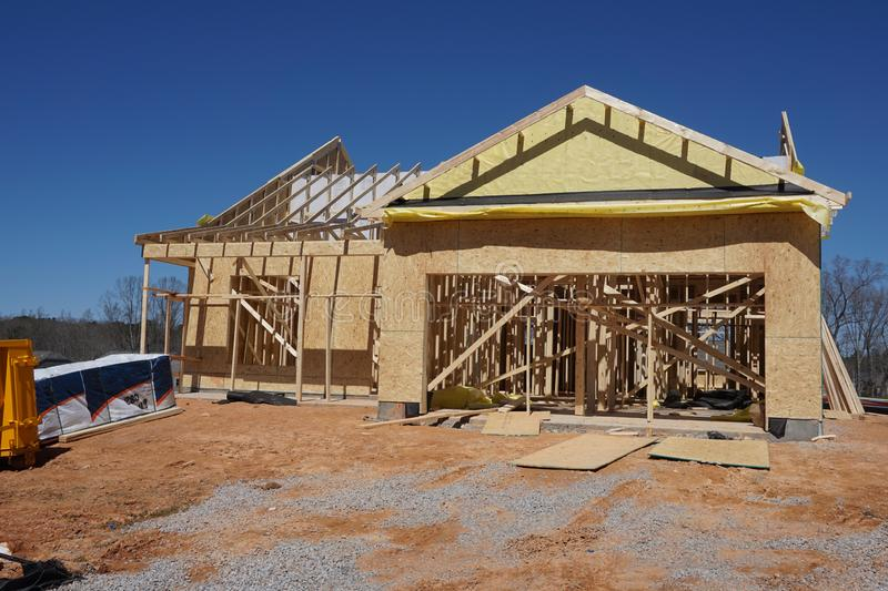 Construction of a suburban home showing the framing stock photo