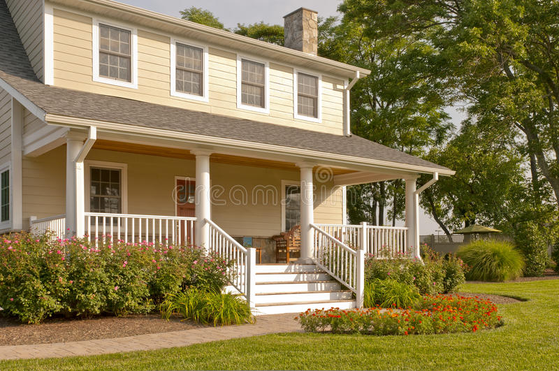 Suburban house with white porch stock photography