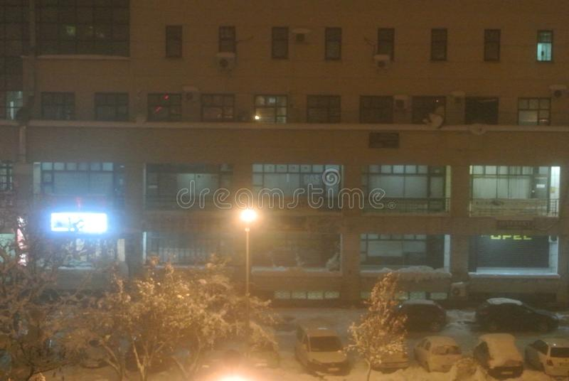 Suburban mall on a winter night. Photo of a city mall under snow on a gloomy winter night royalty free stock photography
