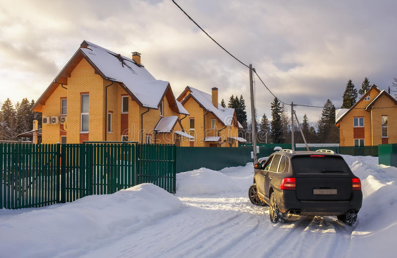 Suburban neighborhood street in winter time. Country cottage. First snow stock photos